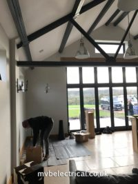 Hanging fireplace being fitted -preparing the space