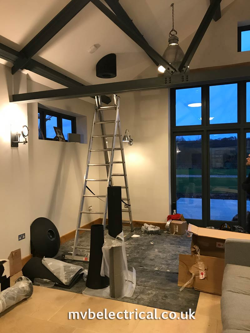Hanging fireplace being fitted - ladder to roof to join the flue to the chimney