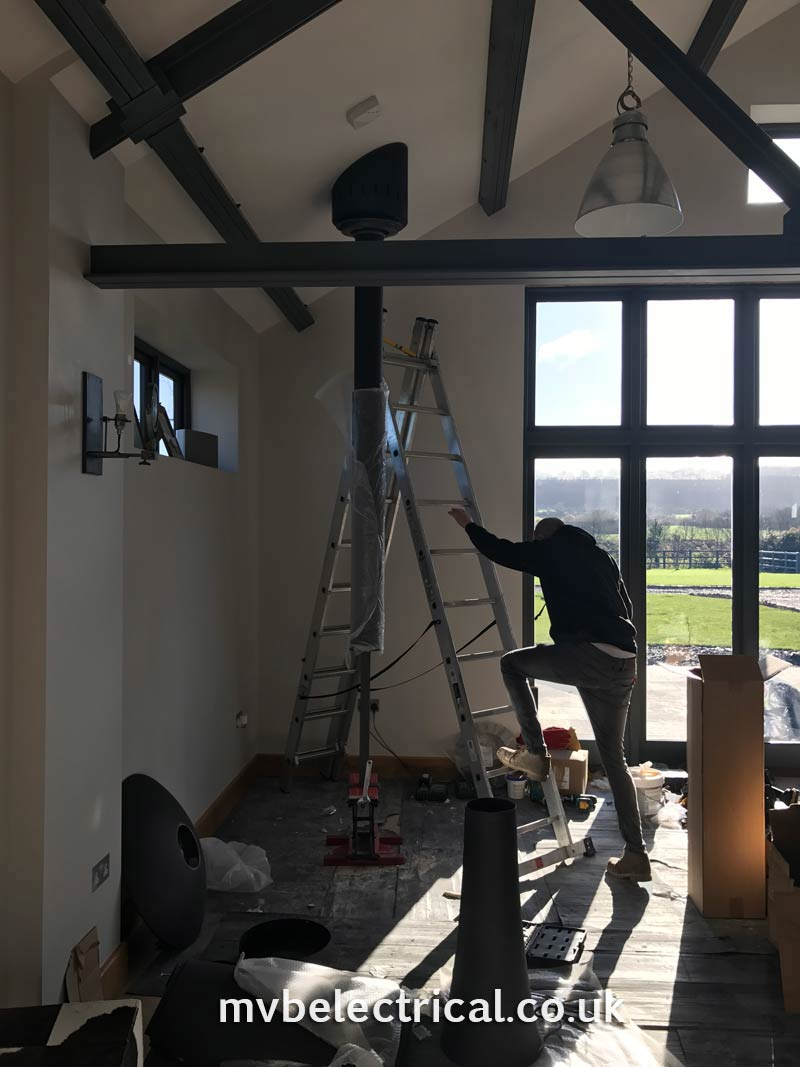 Flue suspended from the ceiling for hanging fireplace