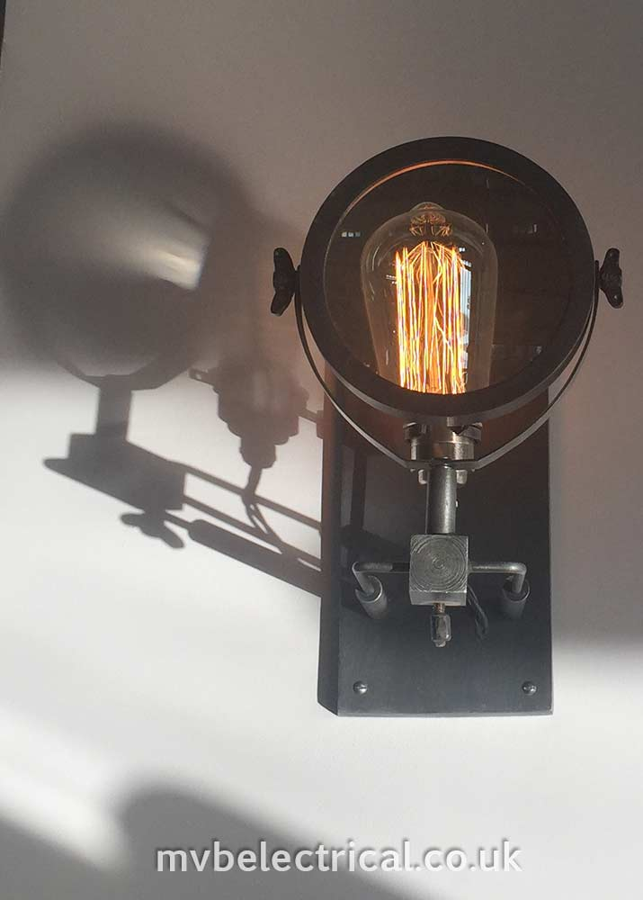 Bespoke lighting - magnifying glass and bulb - installation by MVB Electrical