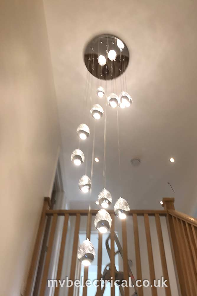 Dangling cluster lights above stair well - electrical work by MVB Electrical