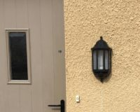 lantern style light flat against the wall