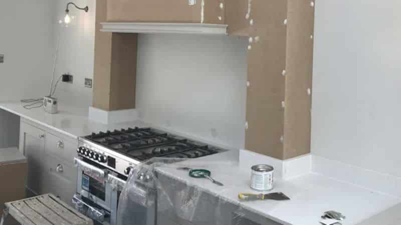 kitchen cooker, extractor and lighting installed